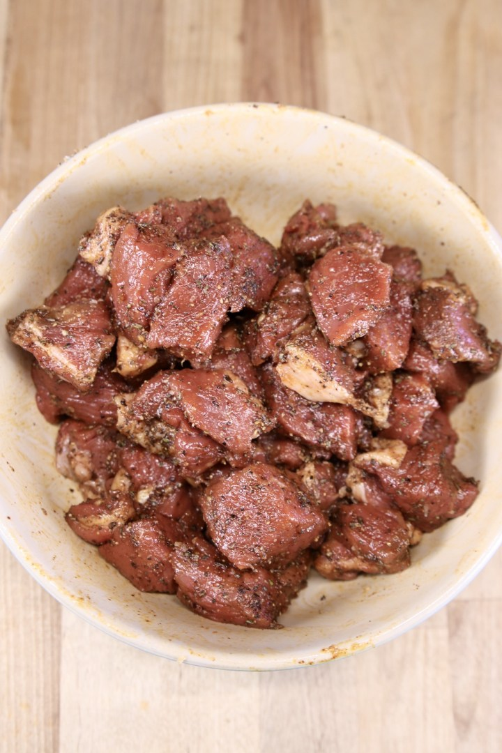 bowl of sirloin chunks with dry rub