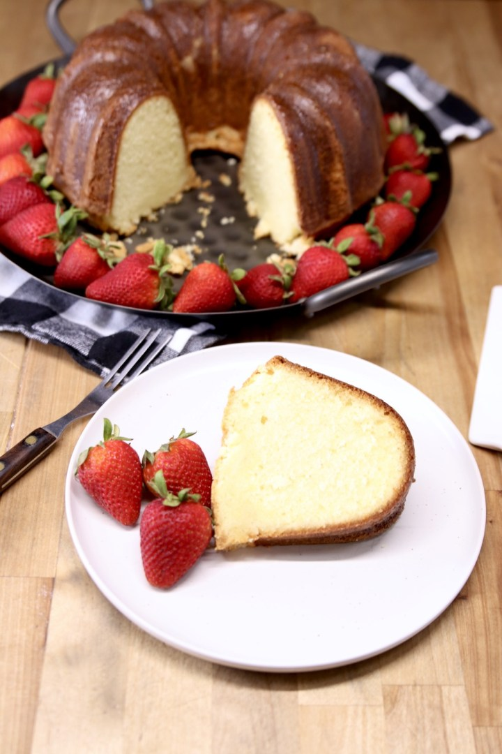 slice of pound cake with fresh strawberries on a plate