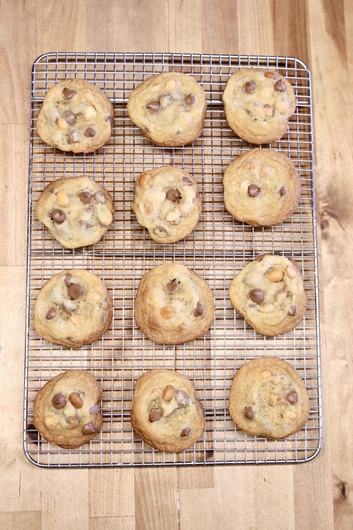 wire rack of baked chocolate chip cookies