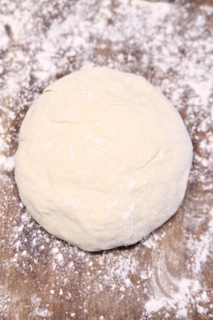 Pizza dough on a floured board