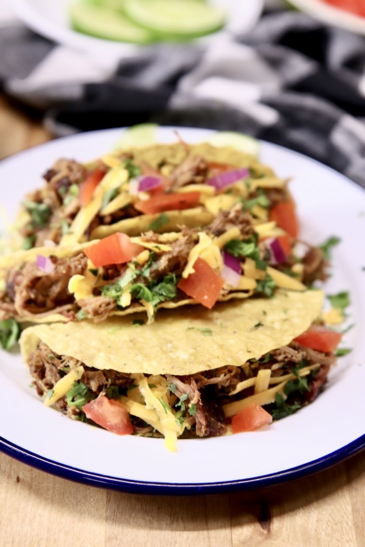 smoked pork tacos with tomatoes and cheese