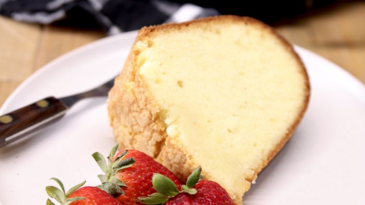slice of Amaretto pound cake with strawberries on a plate