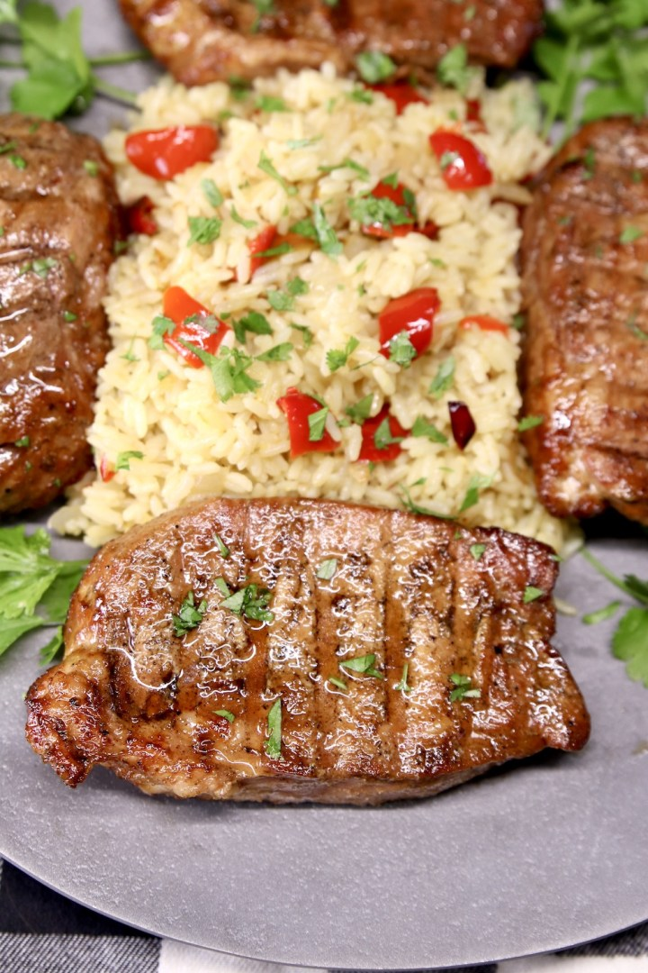 Asian Pork Chops with rice on a platter
