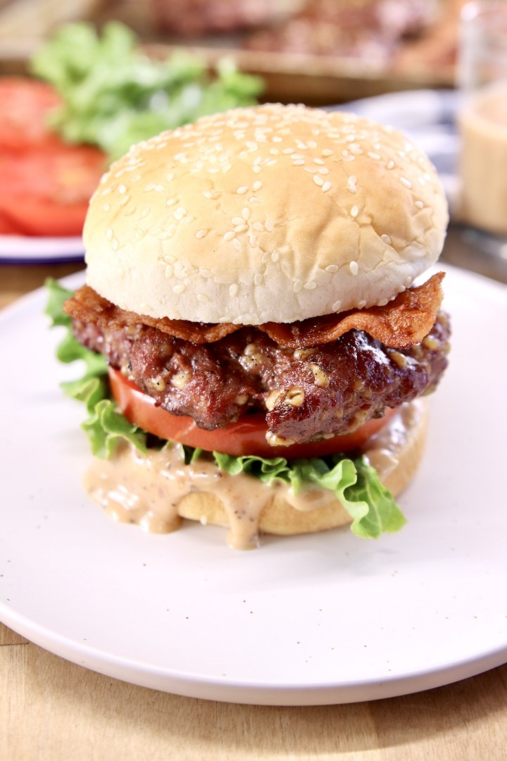 Grilled burger with lettuce, tomato, bacon
