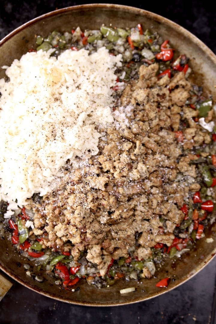 Skillet with cooked peppers, sausage and white rice