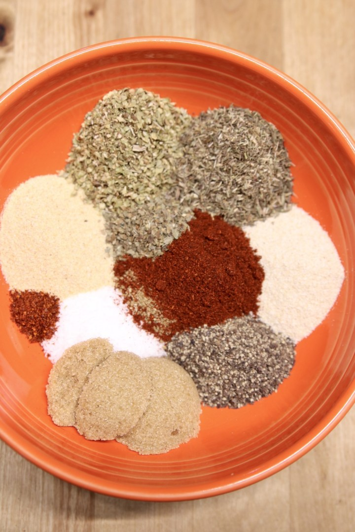 spices and herbs in a bowl for Italian sausage