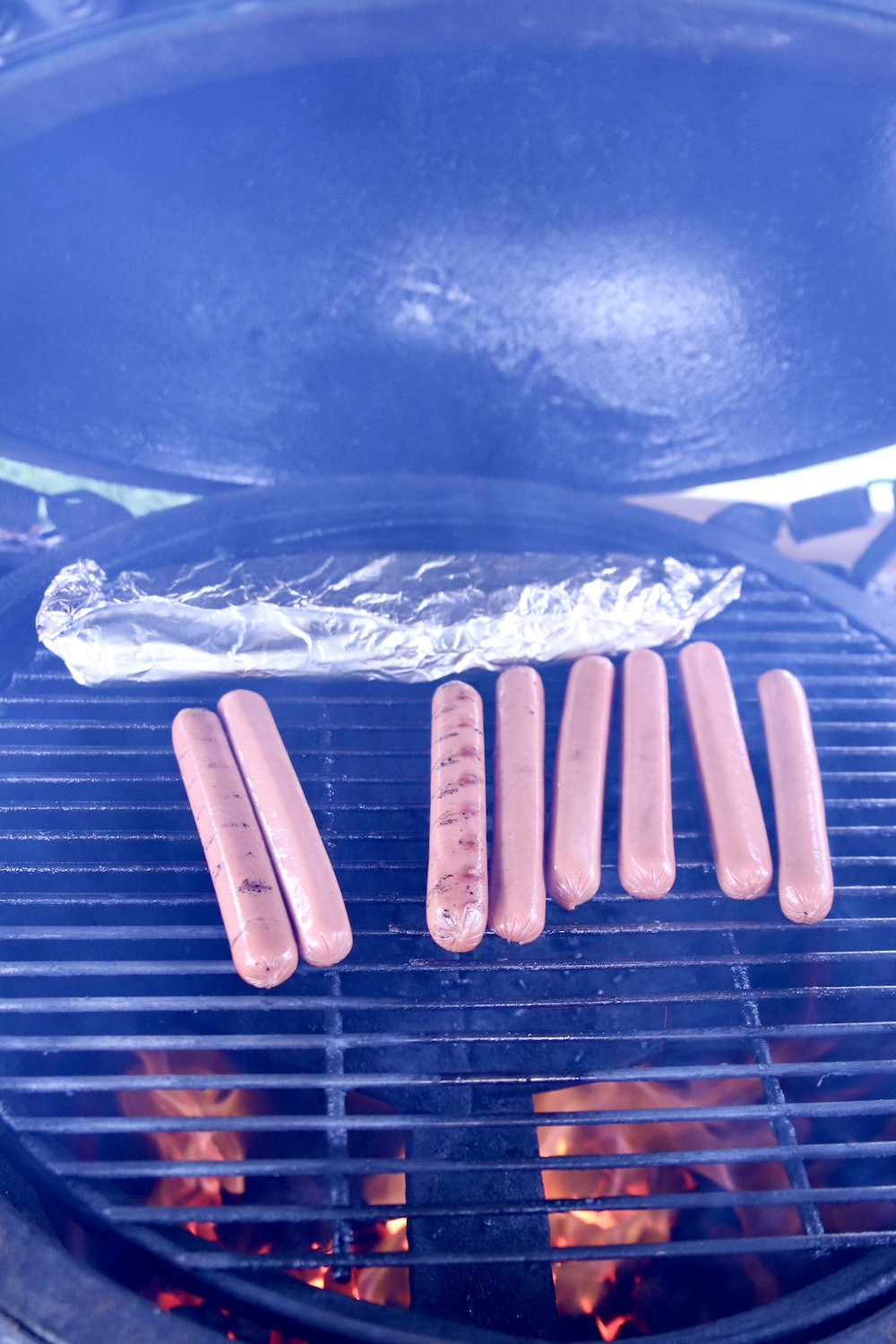 hot dogs on a grill