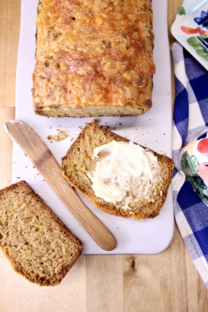 Cheddar Beer Bread - sliced with butter