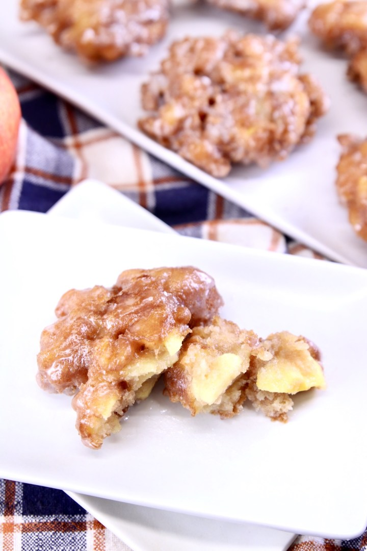 closeup of apple fritter on a plate, broke in half