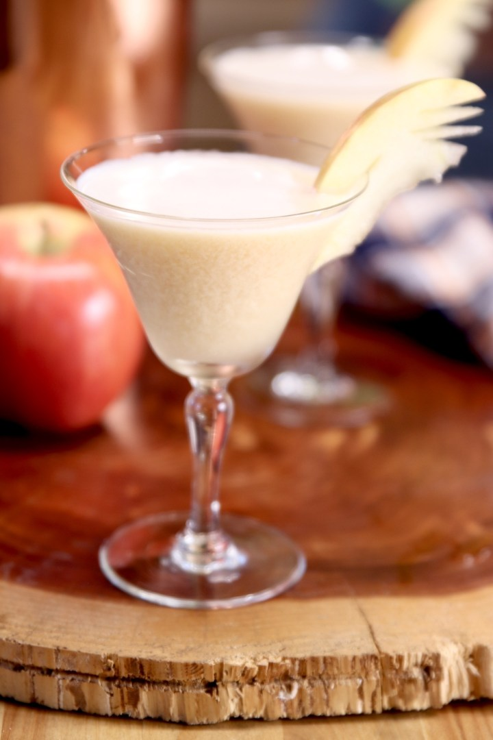 coupe glass with vodka martini - apple garnish