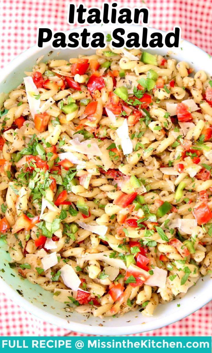 Italian Pasta Salad in a bowl - text overlay