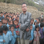 Nepal Mission Rajendra-Nhisutu-is-with-children EDUCATIONAL TOURISM