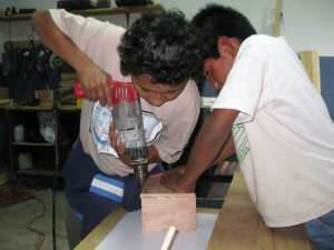 Geovanni and Chupete in carpentry class