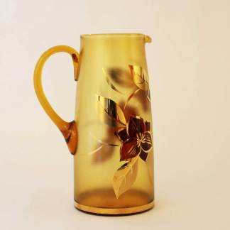 Glass water pitcher. Amber with gold leaf motif.