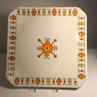 Square plate with orange motif