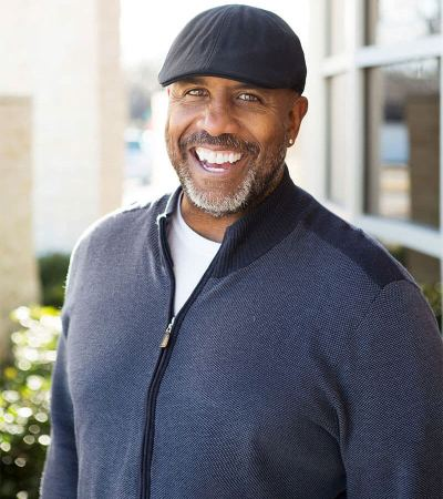 African American mature man wearing a hat and smiling