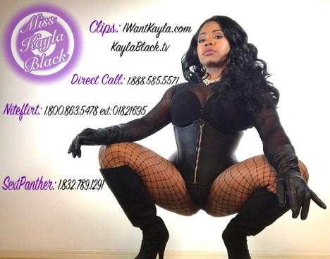 Black Goddess squatting next to her phone numbers