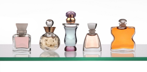 perfume bottles on glass shelf from istockphoto