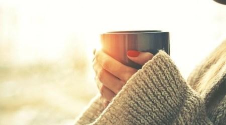 Hands Holding a Mug of Tea or Coffee
