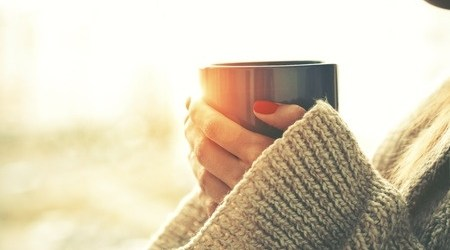 Hands Holding a Mug of Tea or Coffee