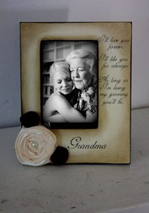 Woman and grandmother picture frame to cope with death of a loved one