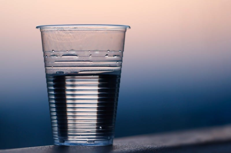 cup of water sitting on table crucial to maintain a beauty regime