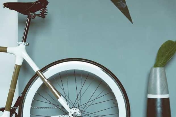 back wheel of bike against blue wall representing lenten resolution
