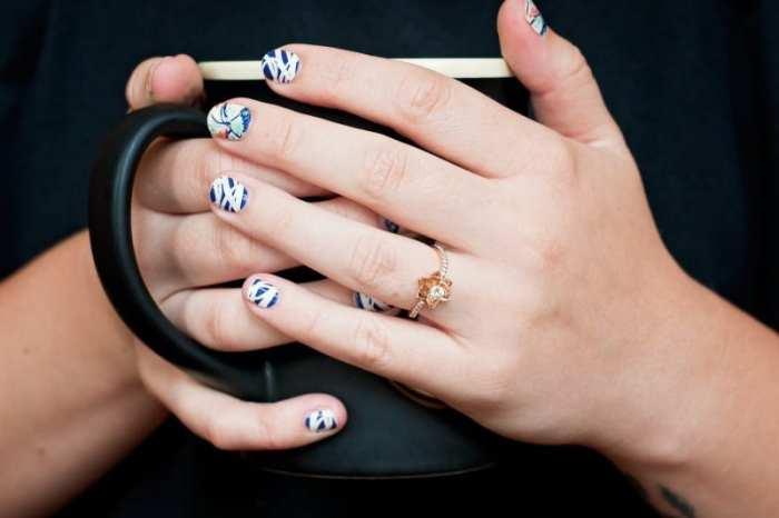 hands holding black mug while planning wedding prep