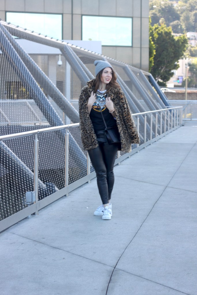 leather leggings and a leopard coat