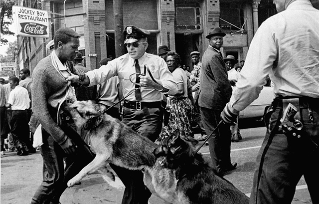 ** FILE ** A 17-year-old civil rights demonstrator, defying an anti-parade ordinance in Birmingham, Ala., is attacked by a police dog in this May 3, 1963 file photo. On the afternoon of May 4, 1963, during a meeting at the White House with members of a political group, President Kennedy discussed the photo which had appeared on the front page of that days New York Times. The John F. Kennedy Library and Museum in Boston released the tape, which was captured on the White House recording system, to coincide with Martin Luther King Day Monday.  (AP Photo/Bill Hudson, File) MAMD101  (BILL HUDSON / The Associated Press)