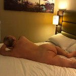 naked man relaxing on bed