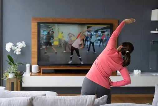 how to save money on cable- girl exercising