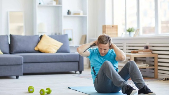 fitness hacks- man doing sit-up  in house