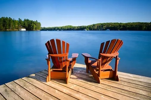 retire early- two chairs by lake