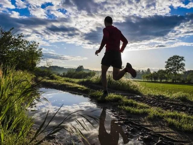 Michael Jordan- man running next to stream