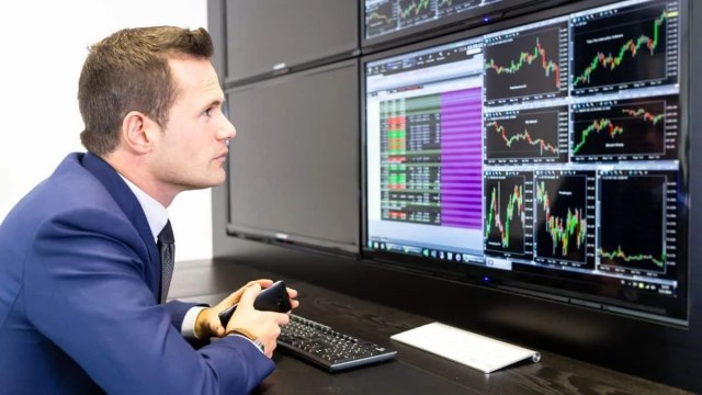 Stock broker looking at the Most Undervalued Stocks Today