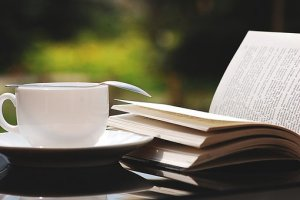 open book with coffee cup