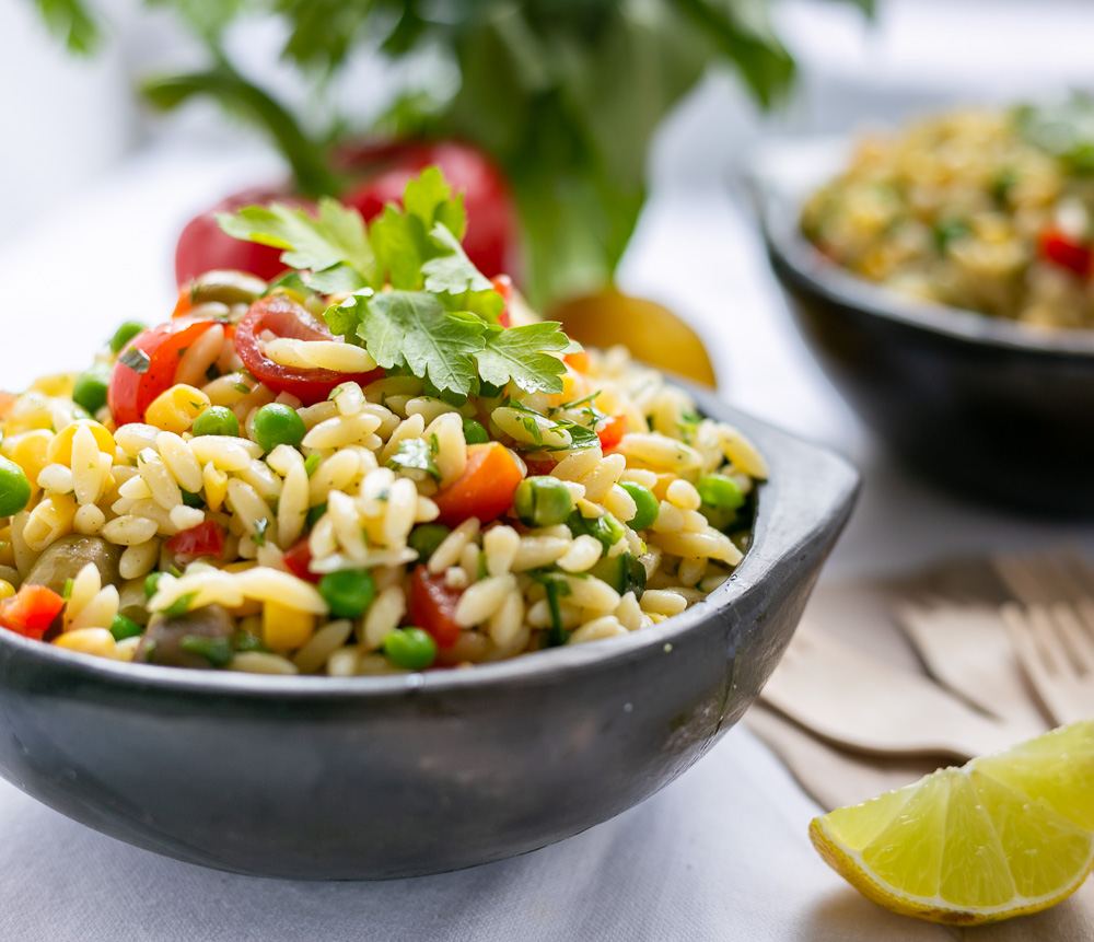 orzo pasta salad on a bowl with parsley