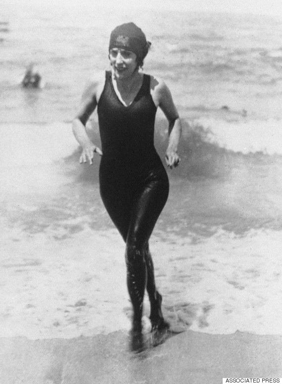Australian professional swimmer Annette Kellerman walks out of the water on July 27, 1928 at Deauville, France in a complete black bathing suit. (AP Photo)