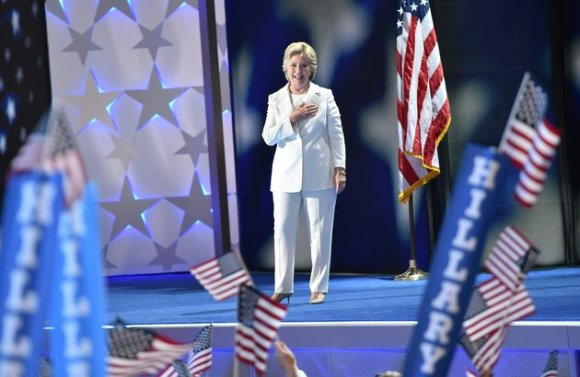 Democratic presidential nominee Hillary Clinton arrives on stage during the fourth and final night of the Democratic National Convention at Wells Fargo Center on July 28, 2016 in Philadelphia, Pennsylvania. . / AFP / Nicholas Kamm (Photo credit should read NICHOLAS KAMM/AFP/Getty Images)
