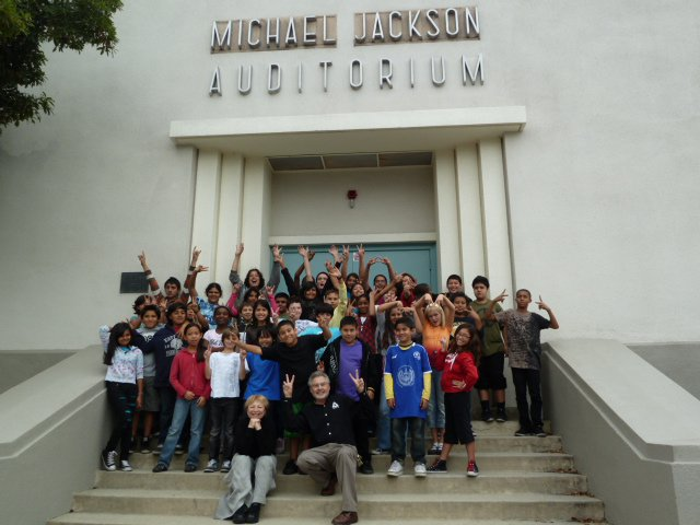 Principal Urbina and Gardner St. Students in front of Michael Jackson Auditorium