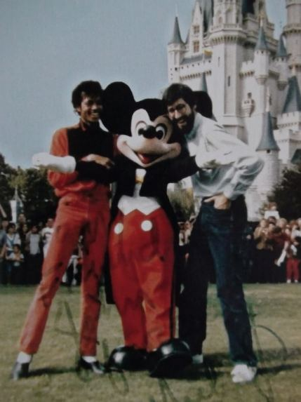 Just before the sea of people arrived and Michael, Mickey and John were whisked into a limo for safety.