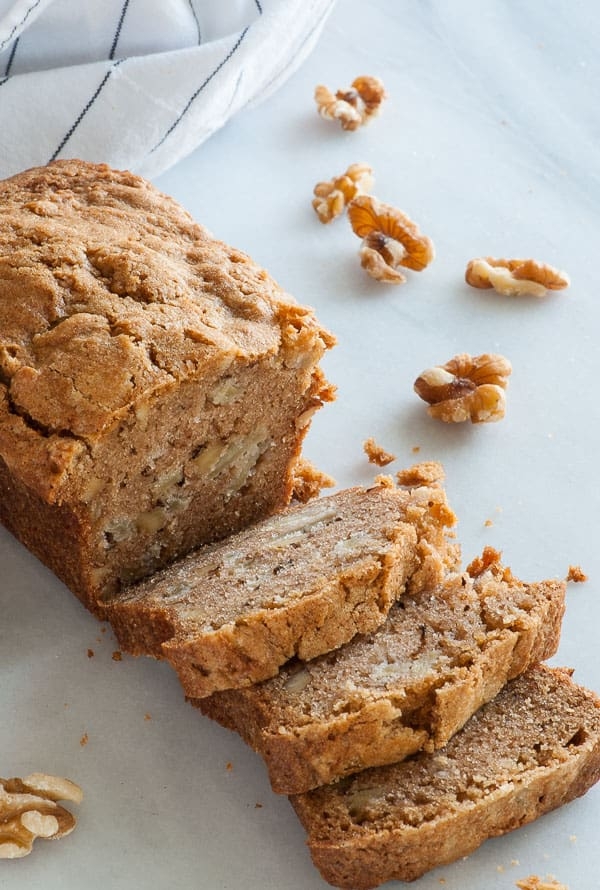 Apple walnut cake. This moist cake recipe is filled with apples and walnuts and is topped with a swoon-worthy rum butter sauce. | mjbakesalot.com