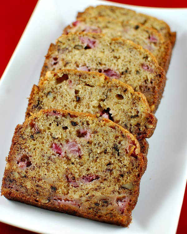 Your grandmother's banana bread is updated with juicy strawberries and crunchy walnuts in an easy recipe that you'll want to make often. With or without a smear of cream cheese, strawberry banana walnut bread makes a great breakfast, afternoon snack, or dessert.   mjbakesalot.com