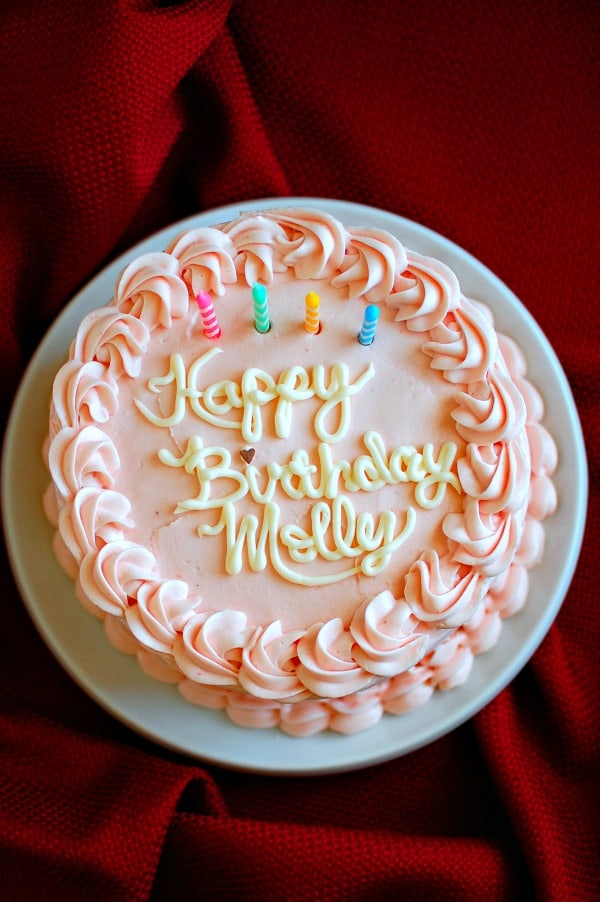 Easy moist white layer cake with fresh strawberry cream cheese frosting is perfect for a birthday, an anniversary, or Easter dinner and can be made the day before you plan to serve it. The combination is so fabulous your friends and family may not believe you made it, so take a couple of photos for proof and bask in the warmth of their praise. | mjbakesalot.com