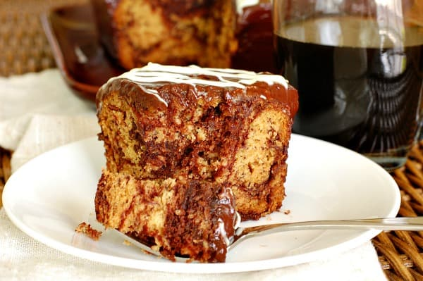 An easy recipe that's perfect for a potluck is luscious chocolate swirl banana cake. | mjbakesalot.com