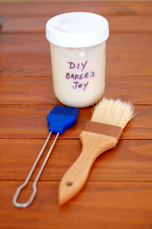 DIY baker's joy shown with a silicone brush with bristles which may work with regular cake pans, and a natural bristle brush which works best for Bundt pan prep to get into all the nooks and crannies. | mjbakesalot.com