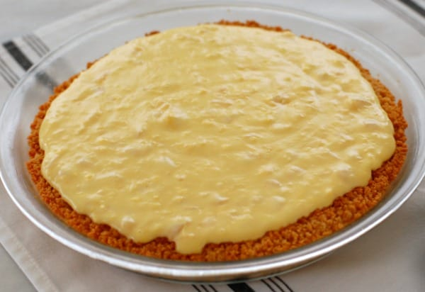 The prepared filling was added to the baked and cooled crust, the filling was added, and now the piña colada pie is chilled and ready to be topped. | mjbakesalot.com