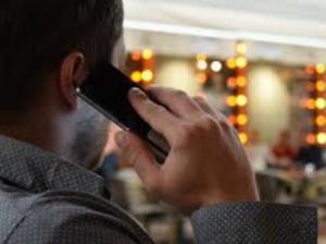 Man talking to his phone
