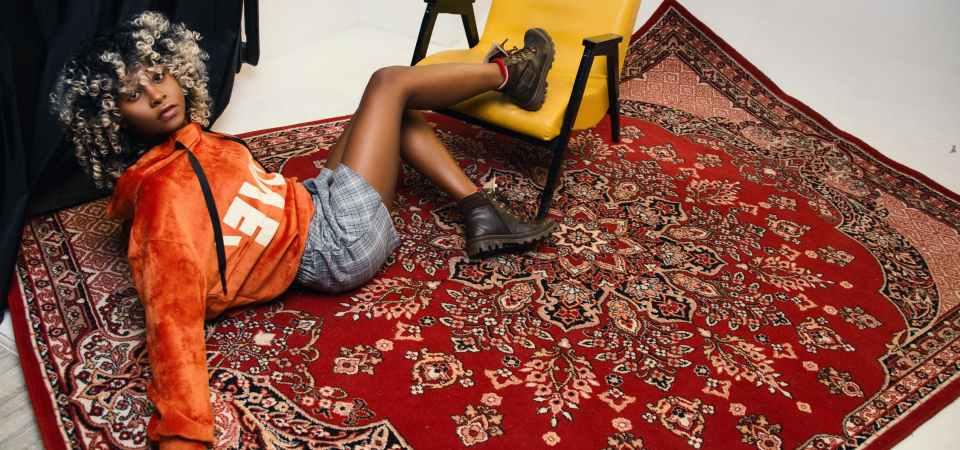 Woman lying on the carpet
